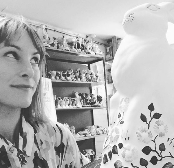 Illustrator Laura Gill eyeing up a Rabbit at Rye Pottery before she paints it